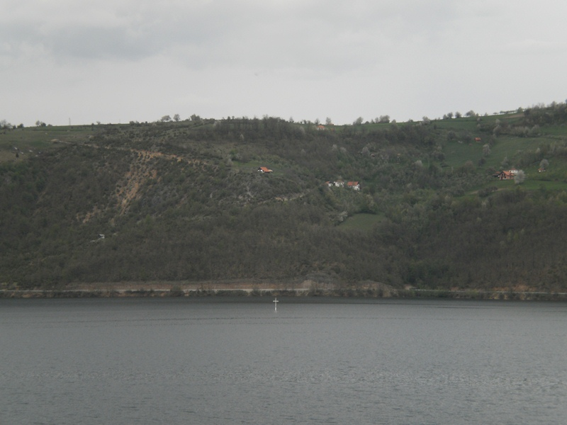 The top of the church appears in the lake